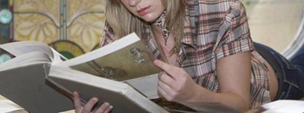 Girl reading a book in Grove Library